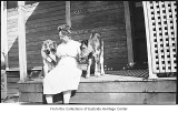 Mary Cruse with calf and Laddie the dog, Bellevue, ca. 1920