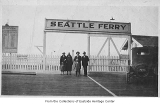 People posing with Seattle Ferry sign on Medina ferry dock, Medina, ca. 1925