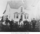 McRedmond family outside their house, Redmond, ca. 1886