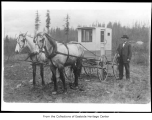 P.A. Anderson with mail delivery buggy, Redmond, 1910