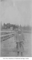 Charles Eminson on Bellevue ferry dock, Bellevue, 1920