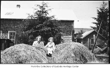 Grace and Phyllis Hill with haystack, Bellevue, 1919