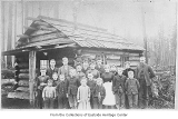 Ed Turner with his students outside first Redmond school, Redmond, 1887