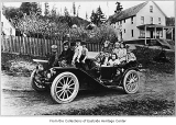 Children in Monohon's first car, ca. 1910
