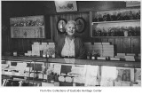 Mina Mary Schafer behind counter of Jane McDowell's Candies, Bellevue, ca. 1940