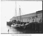 Lizzie Colby, a halibut schooner, moored to a pier, n.d.