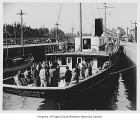 Baltimore, a steam yacht moored with many people on board in the Chittenden Locks, Ballard, n.d.