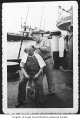 Captain Ray Quinn cutting a man's hair aboard the tug Neptune, n.d.