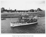 Casco, a diesel powered yacht in a canal and serving as a press boat, n.d.