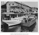 Averilla, a gasoline powered boat, and Principia, a diesel powered yacht, in the harbor near...