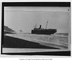 Bear, a passenger steamer, in surf broadside, view from the beach, 1916