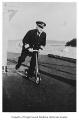 Captain Oliver Van Nieuwenhuise riding a scooter on the Vashon ferry, n.d.