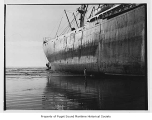 Lipari, a steam freighter, beached south of Grays Harbor, view of side and stern, 1959