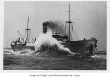 Evanger, a freight steamer, ashore and hit by a big wave, n.d.