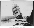 Glenesslin, a full rigged sailing ship, wrecked on a rocky coastline near Manzanita, Oregon, 1913