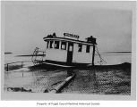 Macray, a diesel powered fishing boat, wrecked, its pilot house above sand in the Gulf of Alaska,...