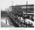 Crowd awaiting the departure of Ohio, a passenger vessel, from Pier 6 on the Seattle Waterfront,...