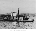 Eagle, a steam tugboat, in a harbor, n.d.