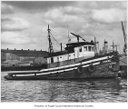 Crane, a diesel powered tugboat, moored in a harbor, n.d.