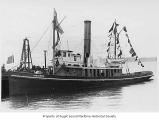 Wanderer, a steam tugboat, at a pier, n.d.