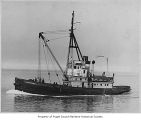 Commissioner, a diesel powered tugboat, at sea, n.d.