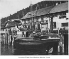 Tiny Boy, a boat, moored at a pier, n.d.