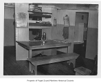 Commodore, a four-mast sailing schooner, interior, crew mess area, n.d.