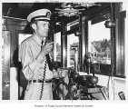Captain William M. Morgan at the helm of the sternwheeler workboat W. T. Preston, May 20, 1975