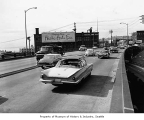 Cars driving near Arctic Fur Co., Seattle, 1964