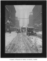 Cars and streetcar stuck in snow on Pike Street, Seattle, 1916