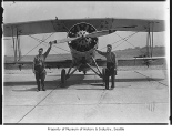 Sgt. Charles Laidlaw and Sgt. Herrick with plane at Sand Point, Seattle, August 26, 1934