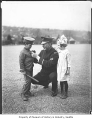 Police captain Kimball with two John Muir School students, Seattle, ca. 1922