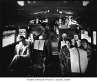 Passengers on bus, Seattle, 1935