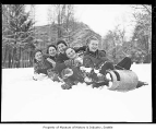 Girls on a toboggan, possibly in Seattle, 1937