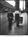 Streetcar employee selling tokens, Seattle, ca. 1925