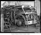Men building a bus at Pacific Car and Foundry factory, Renton, 1938