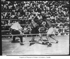 Jack Dempsey and Tommy Gibbons in boxing match, Seattle, July 4, 1923