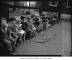 Children with drinking mugs outside Seattle Day Nursery, Seattle, 1942