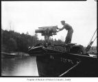 Man with harpoon cannon, Bellevue, ca. 1925