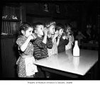 Children drinking from mugs at Seattle Day Nursery, Seattle, 1942