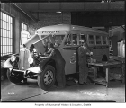 Men building bus in Kenworth plant, Seattle, 1934