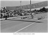 Soap box derby cars at finish line, Seattle, 1971