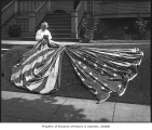 Woman with large American flag, probably in Seattle, ca. 1917