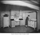 Woman in kitchen, probably in Seattle,, April 29, 1932