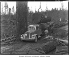 Logs being loaded onto truck, 1937