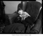 Boy sleeping at the police station in Seattle, February 7, 1936