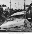 Car crushed by fallen brick during earthquake, Seattle, 1965