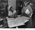 Frank Allen and Esther Ross looking at map to plan tribal fish-in, 1968