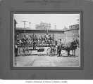 Firemen on horse-drawn wagon, Georgetown, 1909
