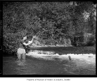 Rita Roberts fishing for trout, July 1941